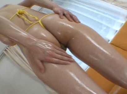 Erika Kirihara rubs hot oil all over her sexy huge tits and her sweet ass