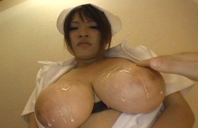 Ayumi Ayukawa Naughty Asian nurse gets loads of cum on her huge hooters